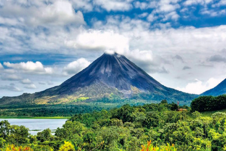 Volcano in Central America with lake and jungle in front of it
