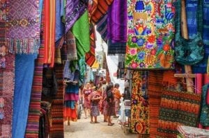 Variety of typical fabrics in the market of Chichicastenango. Guatemala Travel Package