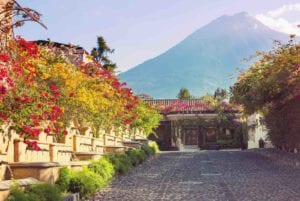 Colonial architecture in Antigua Guatemala with the Volcano de Agua in the background. Discover Guatemala and Belize