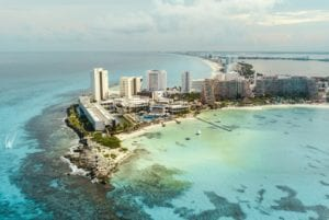 Aerial view of Punta Cancun and the Caribbean ocean in Mexico. Mayan Tour Package