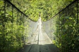 Wooden suspension bridge over river in Panajachel, Guatemala, Central America. Coronavirus Travel Guidelines. Social Distancing.