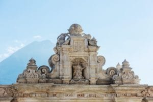 Church in Antigua Guatemala with Volcano de Agua in the background. Guatemala Travel Package