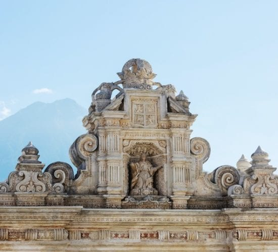 Church in Antigua Guatemala with Volcano de Agua in the background. Guatemala Colonial City and Volcanoes