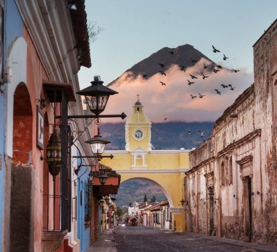 The arc street with Volcano de Agua in the background in Antigua Guatemala
