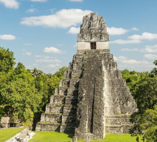 Jaguar temple in the main plaza of the Mayan ruins of Tikal, Guatemala. Trips to Guatemala