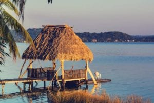 Dock in Lake Peten Itza during sunset. Guatemala, Central America Tours