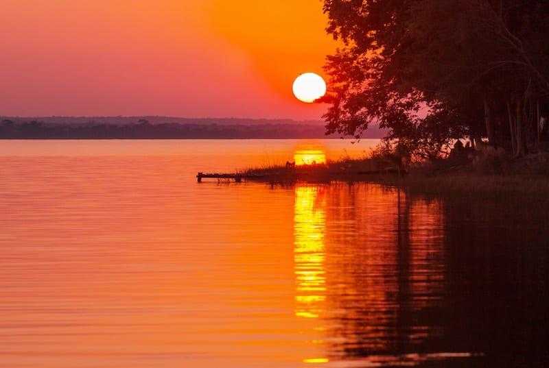 Sunset in Lake Peten, Guatemala. Guatemala Vacation Packages. Sustainable travel itinerary