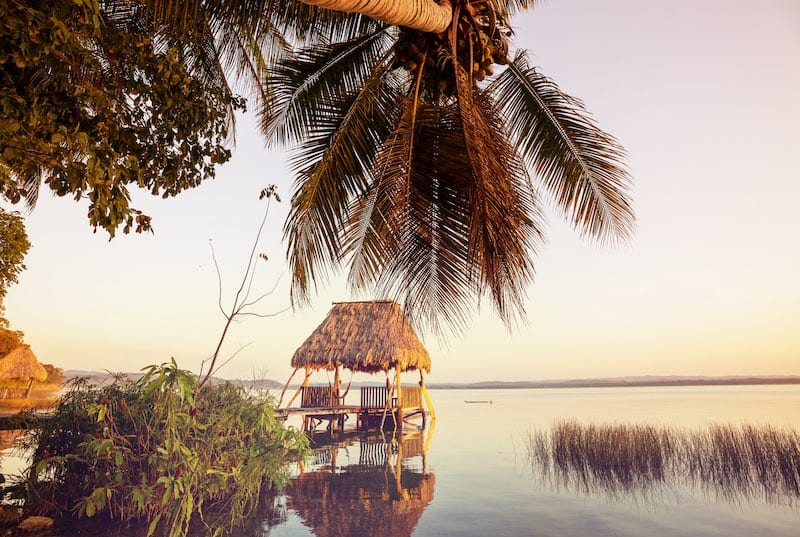 A dock in Lake Peten Itza, Guatemala. Jungle Lakes. Guatemala Vacations