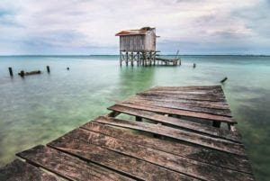 Old dock in the Caribbean Sea in one of the Cases of Belize.