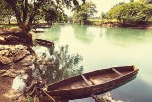 Boat in jungle river in Central America