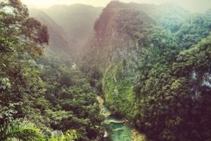 View of Semuc Champey and the breathtaking mountains of this natural park, Guatemala. Coronavirus Travel Guidelines. Social Distancing in open spaces while traveling