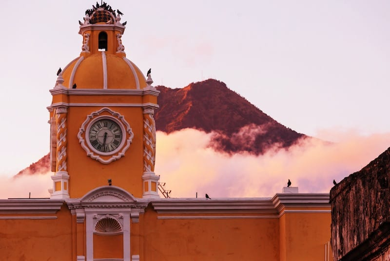 The arc in Antigua Guatemala with Volcano de Agua at the background. Guatemala Tour Packages