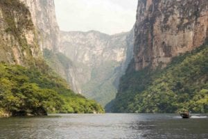 Tour boats and tourists travel through the Sumidero Canyon Chiapas, Mexico