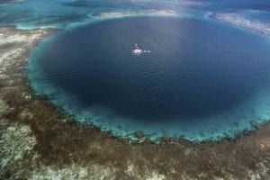 Aerial view of the amazing Blue Hole. Belize Tour Packages