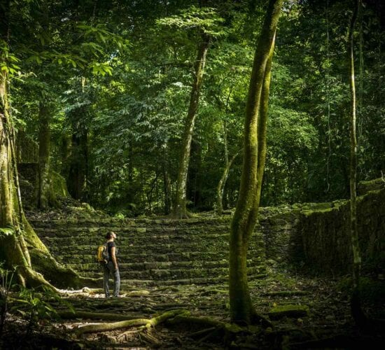 Jungle trek in Mayan Ruins of Guatemala. Responsible Tourism