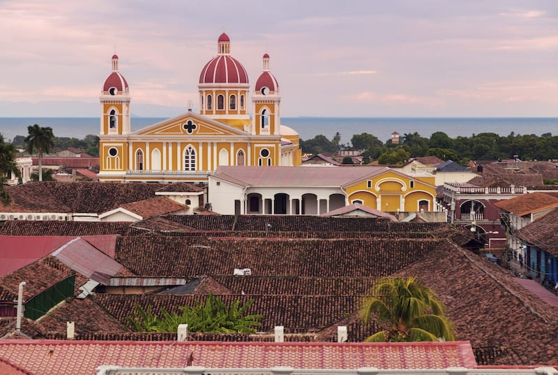 Granada Cathedral and city panorama with the lake Managua in the background. Nicaragua Tours.