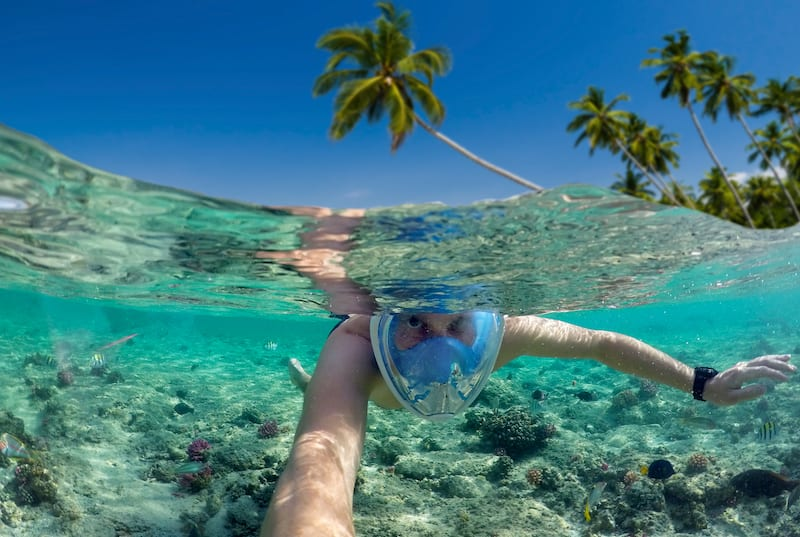 Snorkeling near a tropical island. Roatan beach. Honduras Vacation Tours