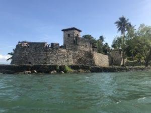 Fortress of the San Felipe de Lara Castle during a boat tour in Rio Dulce, Guatemala